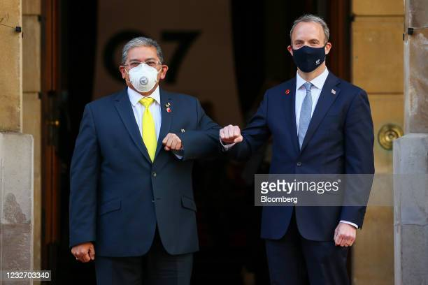Dominic Raab, U.K. Foreign secretary, right, greets Erywan Yuso, Brunei's foreign minister II, on day two of the G-7 foreign and development...