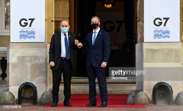 Dominic Raab, U.K. Foreign secretary, right, greets Jean-Yves Le Drian, France's foreign minister, at the G-7 foreign and development...