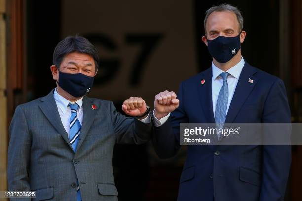 Dominic Raab, U.K. Foreign secretary, right, greets Toshimitsu Motegi, Japan's foreign minister, on day two of the G-7 foreign and development...