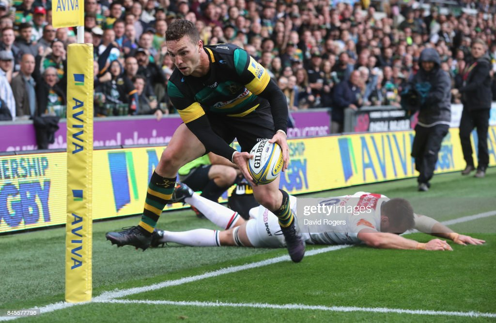 Dominic Ryan of Leicester is injured as he tries to tackle George North during the Aviva Premiership match between Northampton Saints and Leicester Tigers at Franklin's Gardens on September 9, 2017 in Northampton, England.