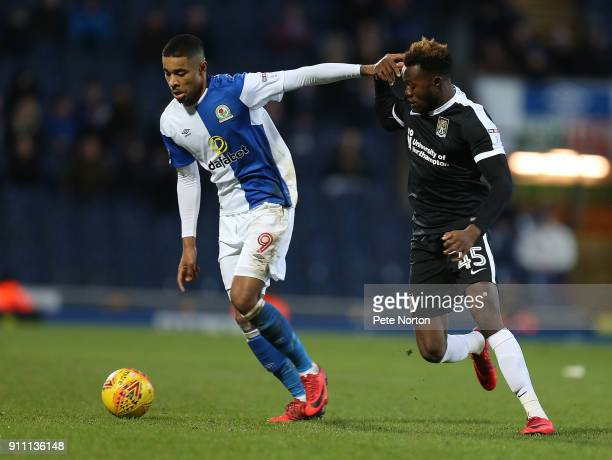 Dominic Samuel of Blackburn Rovers holds off the challenge of Gboly Ariyibi of Northampton Town during the Sky Bet League One match between Blackburn...