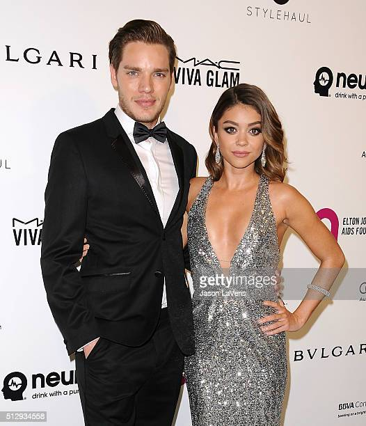 Dominic Sherwood and Sarah Hyland attend the 24th annual Elton John AIDS Foundation's Oscar viewing party on February 28 2016 in West Hollywood...