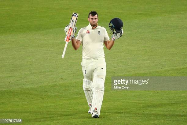 Dominic Sibley of the England Lions raises his bat after scoring a century during the Four Day match between Australia A and the England Lions at...