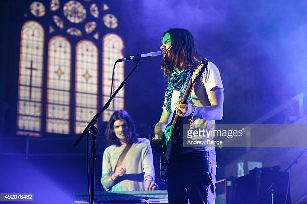 Dominic Simper and Kevin Parker of Tame Impala perform on stage at Albert Hall on July 12 2014 in Manchester United Kingdom