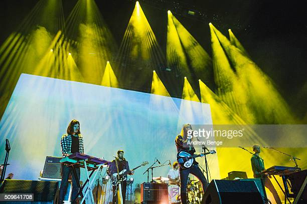 Dominic Simper Kevin Parker and Jay Watson of Tame Impala perform on stage at Manchester Arena on February 11 2016 in Manchester England
