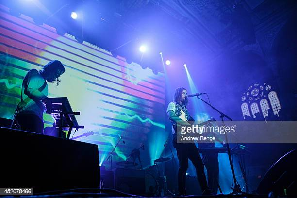 Dominic Simper, Kevin Parker, Jay Watson and Julien Barbagallo of Tame Impala perform on stage at Albert Hall on July 12, 2014 in Manchester, United...