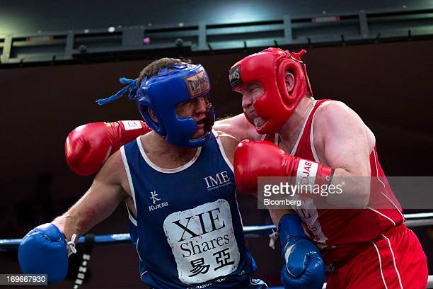 Dominic Smith an area sales manager for HSBC Holdings PLC in red exchanges blows with Ashley Dale chief executive officer of Mirae Assets Securities...