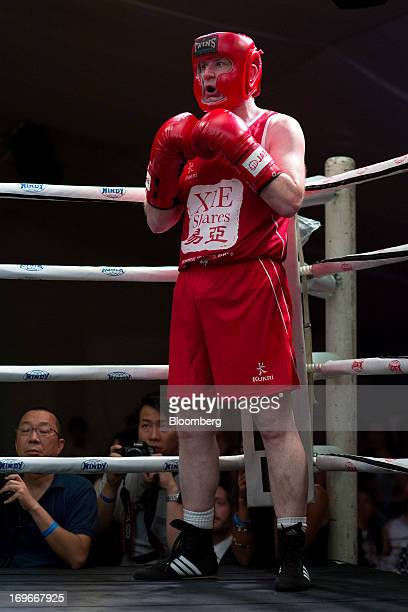 Dominic Smith an area sales manager for HSBC Holdings PLC stands in his corner during the second bout of the Hedge Fund Fight Nite 2013 charity...