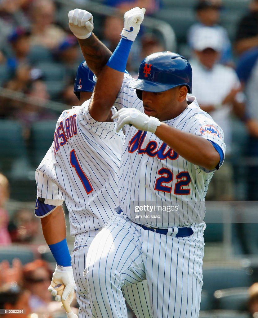 Dominic Smith #22 of the New York Mets celebrates his sixth-inning home run against the Cincinnati Reds with teammate Amed Rosario #1 at Citi Field on September 10, 2017 in the Flushing neighborhood of the Queens borough of New York City.