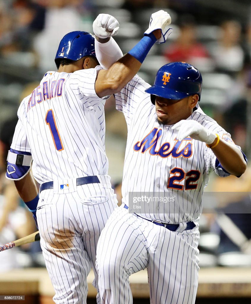 Dominic Smith #22 of the New York Mets celebrates his solo home run with teamamte Amed Rosario #1 in the sixth inning against the Arizona Diamondbacks on August 23, 2017 at Citi Field in the Flushing neighborhood of the Queens borough of New York City.