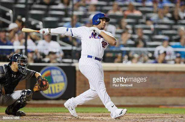 Dominic Smith of the New York Mets hits a home run during the Mets last home game of the season in an MLB baseball game against the Atlanta Braves on...
