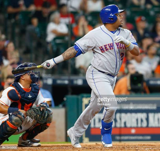 Dominic Smith of the New York Mets hits a home run in the fourth inning as Juan Centeno of the Houston Astros watches the ball at Minute Maid Park on...