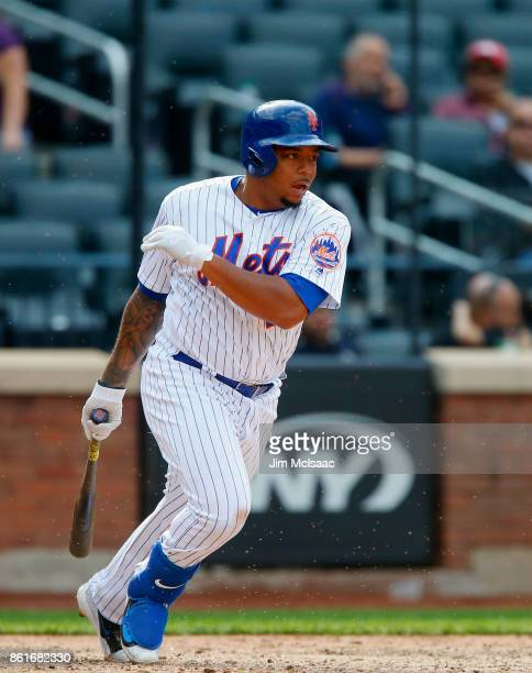 Dominic Smith of the New York Mets in action against the Cincinnati Reds at Citi Field on September 10 2017 in the Flushing neighborhood of the...