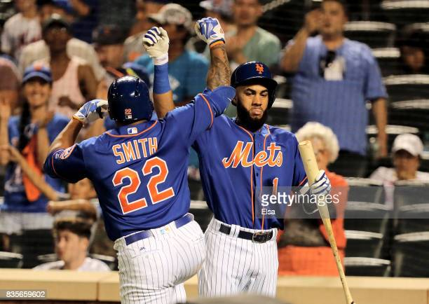 Dominic Smith of the New York Mets is congratulated by teammate Amed Rosario of the New York Mets after Smith hit a solo home run in the eighth...