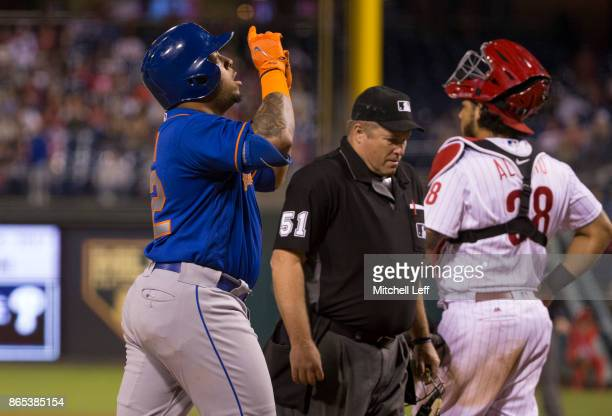 Dominic Smith of the New York Mets reacts in front of Jorge Alfaro of the Philadelphia Phillies after a home run at Citizens Bank Park on September...
