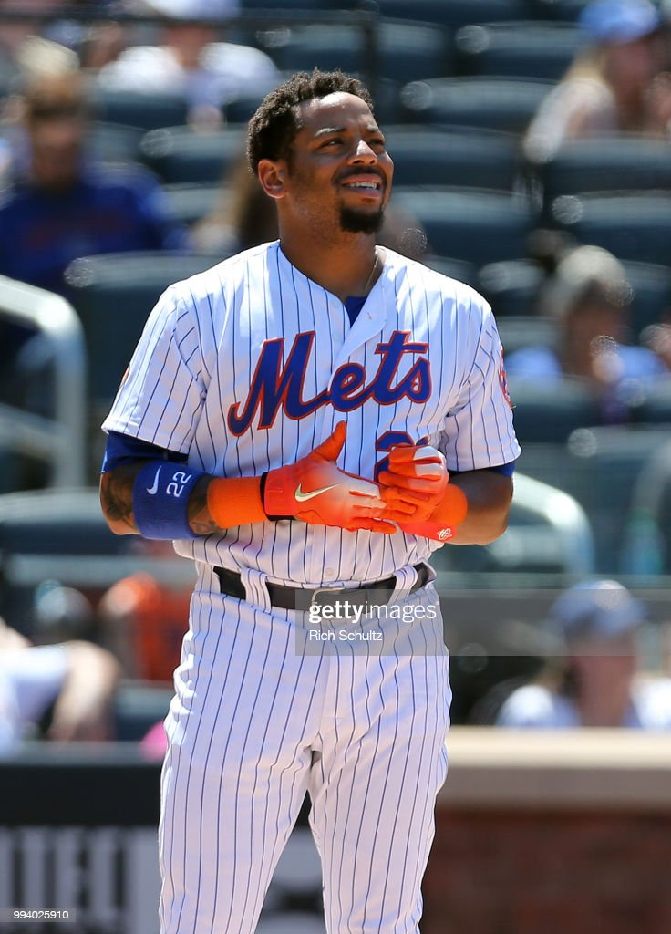 Dominic Smith #22 of the New York Mets reacts to striking out in the eighth inning, his third of the game against the Tampa Bay Rays at Citi Field on July 8, 2018 in the Flushing neighborhood of the Queens borough of New York City. The Rays defeated the Mets 9-0.