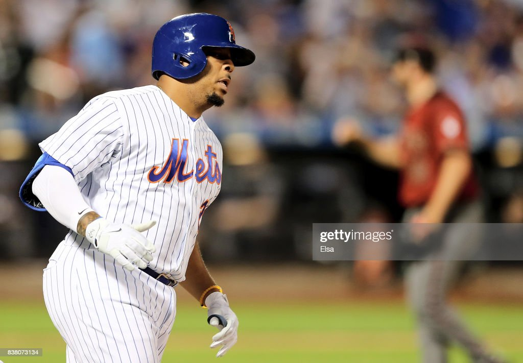 Dominic Smith #22 of the New York Mets rounds first base after he hit a solo home run off a pitch from Jake Barrett #33 of the Arizona Diamondbacks in the sixth inning on August 23, 2017 at Citi Field in the Flushing neighborhood of the Queens borough of New York City.