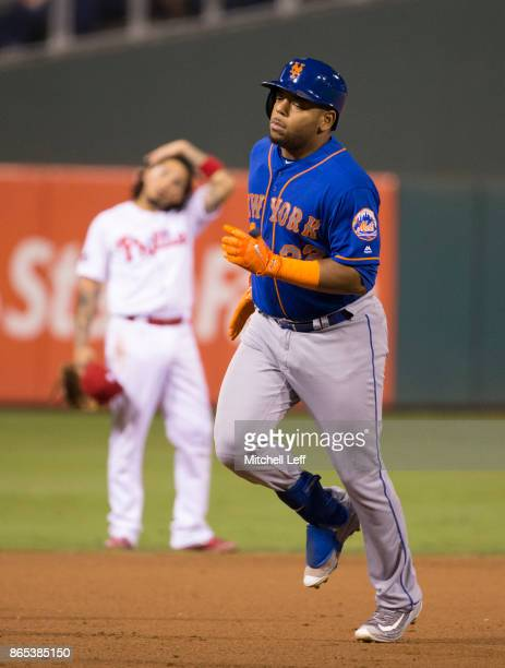 Dominic Smith of the New York Mets rounds the bases in front of Freddy Galvis of the Philadelphia Phillies after a home run at Citizens Bank Park on...