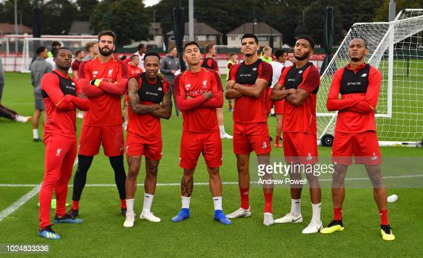 Dominic Solanke Alisson Becker Roberto Firmino Nathaniel Clyne Joe Gomez and Fabinho of Liverpool pose for a photograph after winning a tournament...