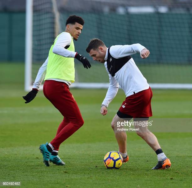 Dominic Solanke and James Milner of Liverpool during the training session at Melwood Training Ground on March 15 2018 in Liverpool England
