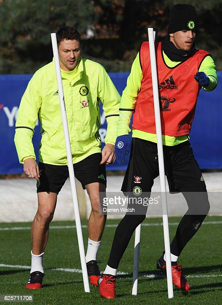 Dominic Solanke and Nemanja Matic perform a drill during a Chelsea training session at Chelsea Training Ground on November 25 2016 in Cobham England