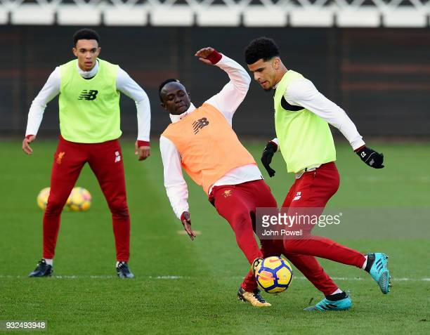 Dominic Solanke and Sadio Mane of Liverpool during the training session at Melwood Training Ground on March 15 2018 in Liverpool England