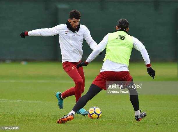 Dominic Solanke and Virgil van Dijk of Liverpool during a training session at Melwood Training Ground on January 31 2018 in Liverpool England