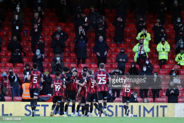 Dominic Solanke of AFC Bournemouth celebrates in front of fans with his teammates after scoring his team's second goal during the Sky Bet...