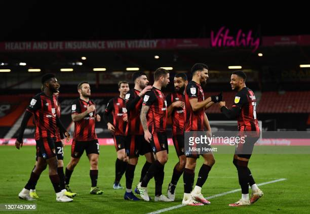 Dominic Solanke of AFC Bournemouth celebrates with Arnaut Danjuma and team mates after scoring their side's second goal during the Sky Bet...