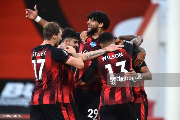 Dominic Solanke of AFC Bournemouth celebrates with his team after he scores his teams fourth goal during the Premier League match between AFC...