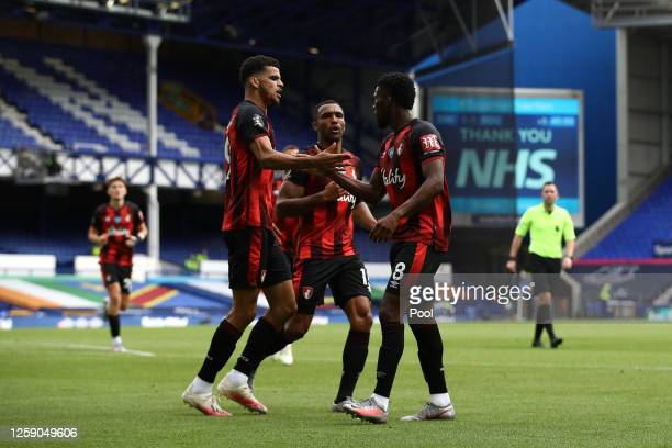 Dominic Solanke of AFC Bournemouth celebrates with teammates Jefferson Lerma and Callum Wilson after scoring his team's second goal during the...