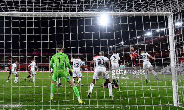 Dominic Solanke of AFC Bournemouth gets up for a header that deflects off Joel Latibeaudiere of Swansea City to score an own goal for AFC...