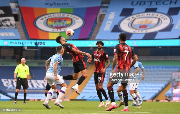 Dominic Solanke of AFC Bournemouth heads the ball during the Premier League match between Manchester City and AFC Bournemouth at Etihad Stadium on...