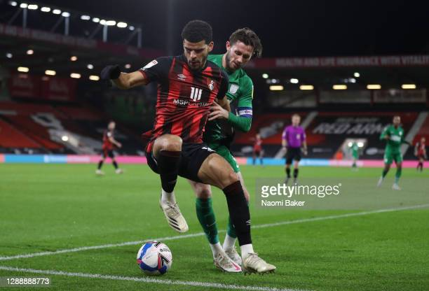 Dominic Solanke of AFC Bournemouth is challenged by Alan Browne of Preston North End during the Sky Bet Championship match between AFC Bournemouth...