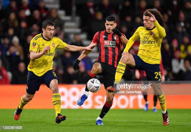 Dominic Solanke of AFC Bournemouth is challenged by Matteo Guendouzi and Sokratis Papastathopoulos of Arsenal during the FA Cup Fourth Round match...