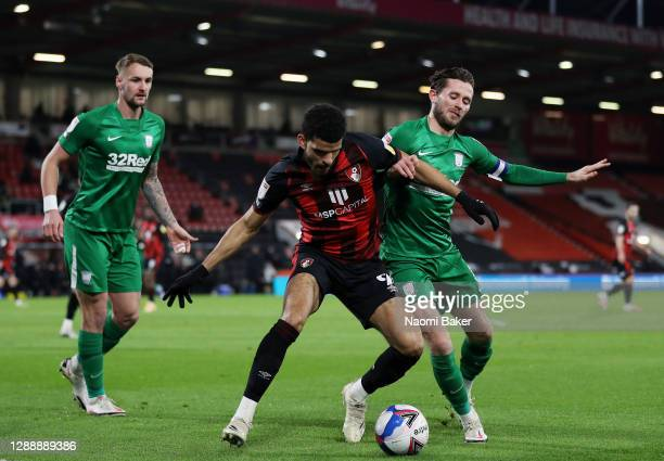 Dominic Solanke of AFC Bournemouth is challenged by Patrick Bauer and Alan Browne of Preston North End during the Sky Bet Championship match between...