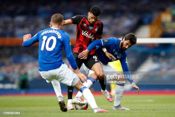 Dominic Solanke of AFC Bournemouth is tackled by Andre Gomes and Gylfi Sigurdsson of Everton during the Premier League match between Everton FC and...