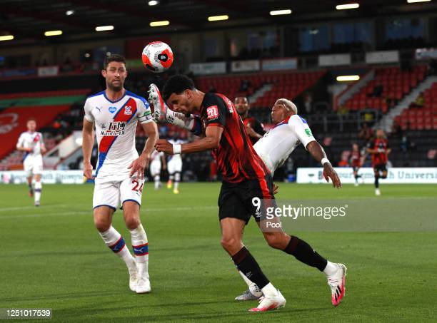 Dominic Solanke of AFC Bournemouth is tackled by Patrick van Aanholt of Crystal Palace during the Premier League match between AFC Bournemouth and...