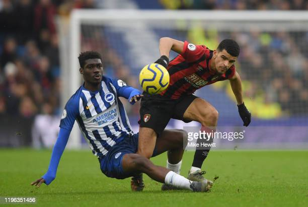 Dominic Solanke of AFC Bournemouth is tackled by Yves Bissouma of Brighton & Hove Albion during the Premier League match between Brighton & Hove...