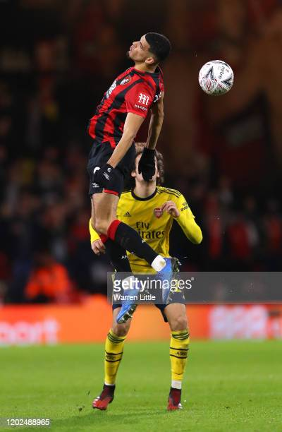 Dominic Solanke of AFC Bournemouth jumps for the ball ahead of Matteo Guendouzi of Arsenal FC during the FA Cup Fourth Round match between...