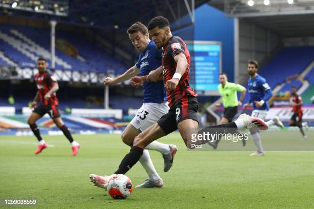 Dominic Solanke of AFC Bournemouth shoots under pressure from Seamus Coleman of Everton during the Premier League match between Everton FC and AFC...