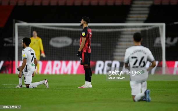 Dominic Solanke of AFC Bournemouth stands as Swansea City players take a knee in support of the Black Lives Matter movement prior to the Sky Bet...