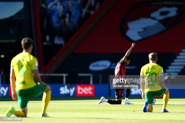 Dominic Solanke of AFC Bournemouth takes a knee in support of the Black Lives Matter movement during the Sky Bet Championship match between AFC...