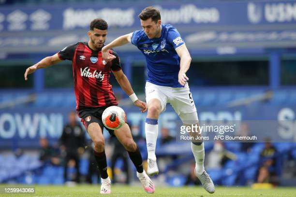 Dominic Solanke of Bournemouth closes down Michael Keane of Everton during the Premier League match between Everton FC and AFC Bournemouth at...