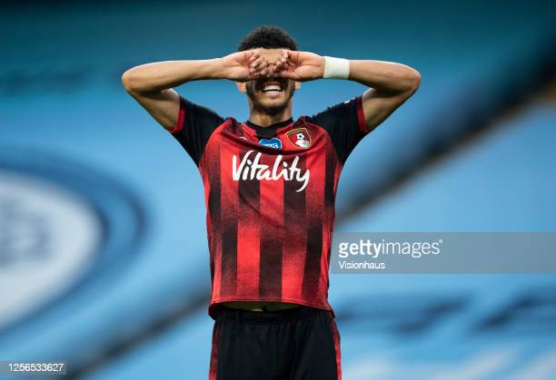 Dominic Solanke of Bournemouth despairs after missing a chance during the Premier League match between Manchester City and AFC Bournemouth at Etihad...