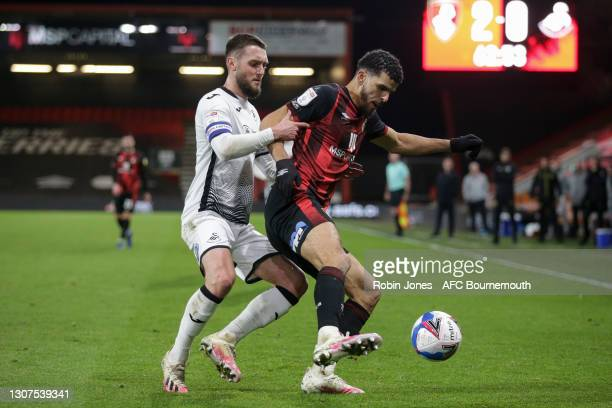 Dominic Solanke of Bournemouth holds off Matt Grimes of Swansea City during the Sky Bet Championship match between AFC Bournemouth and Swansea City...