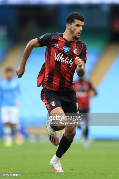 Dominic Solanke of Bournemouth in action during the Premier League match between Manchester City and AFC Bournemouth at the Etihad Stadium on July 15...