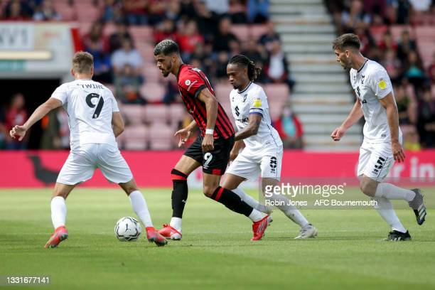 Dominic Solanke of Bournemouth is closed down during the Carabao Cup 1st Round match between AFC Bournemouth and MK Dons at Vitality Stadium on July...