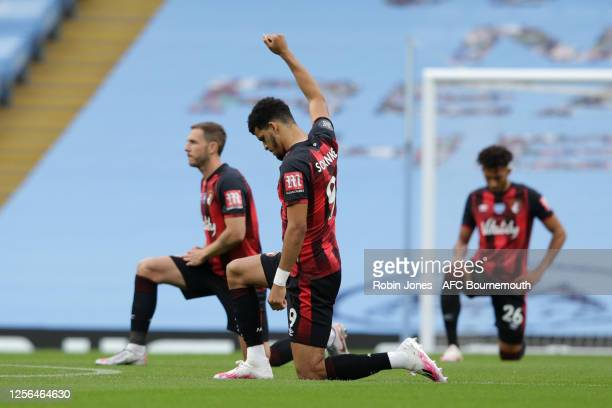 Dominic Solanke of Bournemouth takes the knee in support of the Black Lives Matter campaign during the Premier League match between Manchester City...