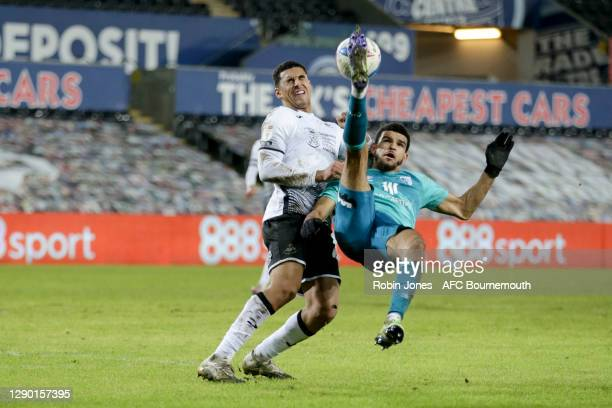 Dominic Solanke of Bournemouth tries an overhead kick against Ben Cabango of Swansea City during the Sky Bet Championship match between Swansea City...